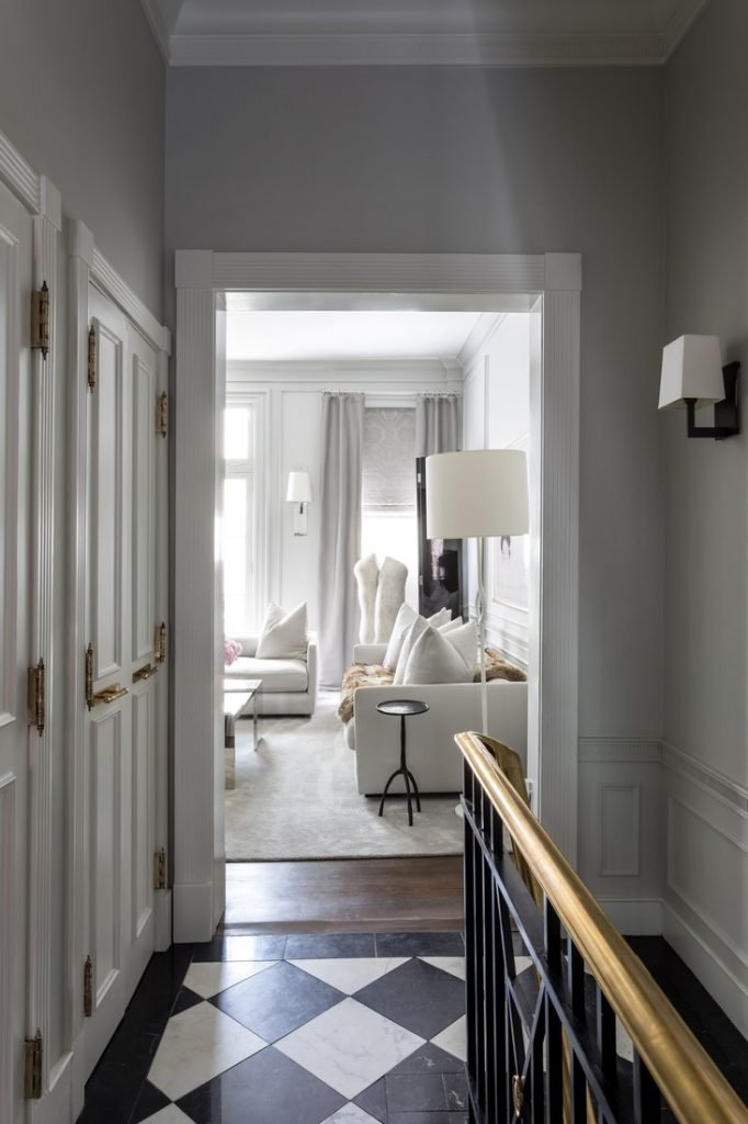 Grey hallway with black and white marble checkerboard floor on Thou Swell @thouswellblog