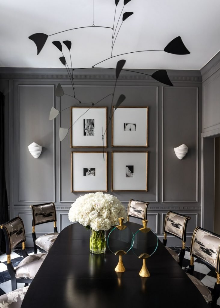 Dark grey dining room with mobile in Ryan Korban townhouse on Thou Swell @thouswellblog