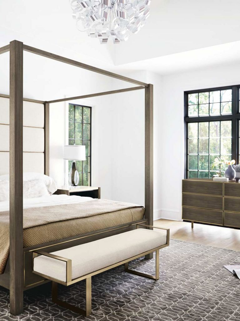 Airy contemporary bedroom with sleek modern bench and canopy bed on Thou Swell @thouswellblog