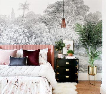 Tropical bohemian bedroom makeover with pink velvet bed and black campaign nightstand on Thou Swell @thouswellblog