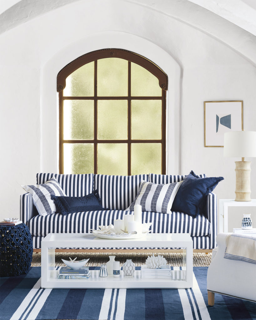 Striped sofa in classic blue and white living room on Thou Swell @thouswellblog