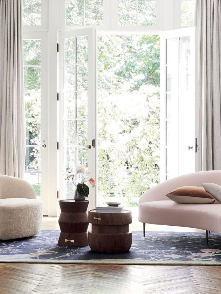 Pale pink curved sofa and chinoiserie rug in CB2 x goop collection on Thou Swell @thouswellblog