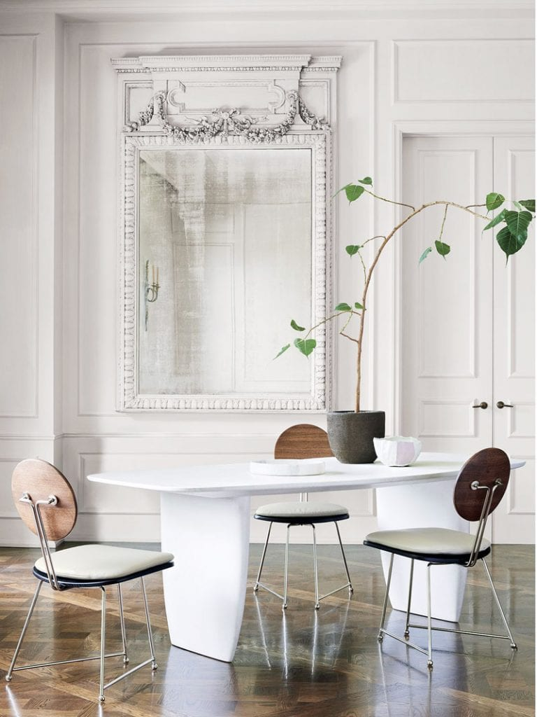 Round-back dining chair and white concrete dining table in CB2 x goop collection on Thou Swell @thouswellblog