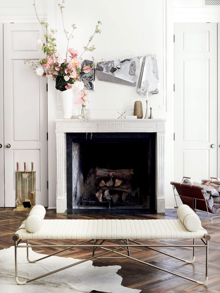 Leather bench with bolster cushions and three-piece mirror set above fireplace mantel in CB2 x goop collection on Thou Swell @thouswellblog