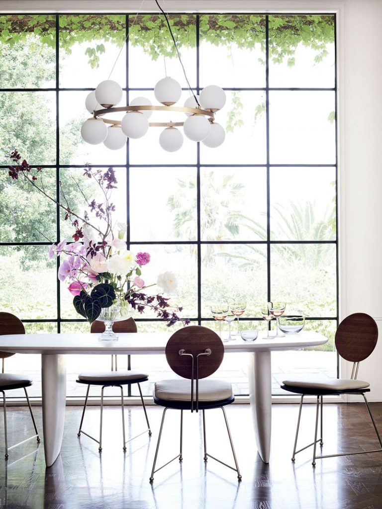 White concrete dining table and modern dining chairs with steel framed window in CB2 x goop collection on Thou Swell @thouswellblog