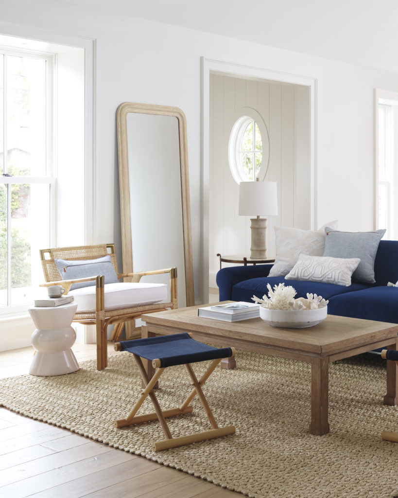 Stunning living room with woven armchair and navy blue sofa on Thou Swell @thouswellblog