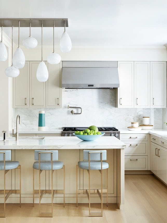 Serene white kitchen with blue counter stools from Luxe Magazine on Thou Swell @thouswellblog