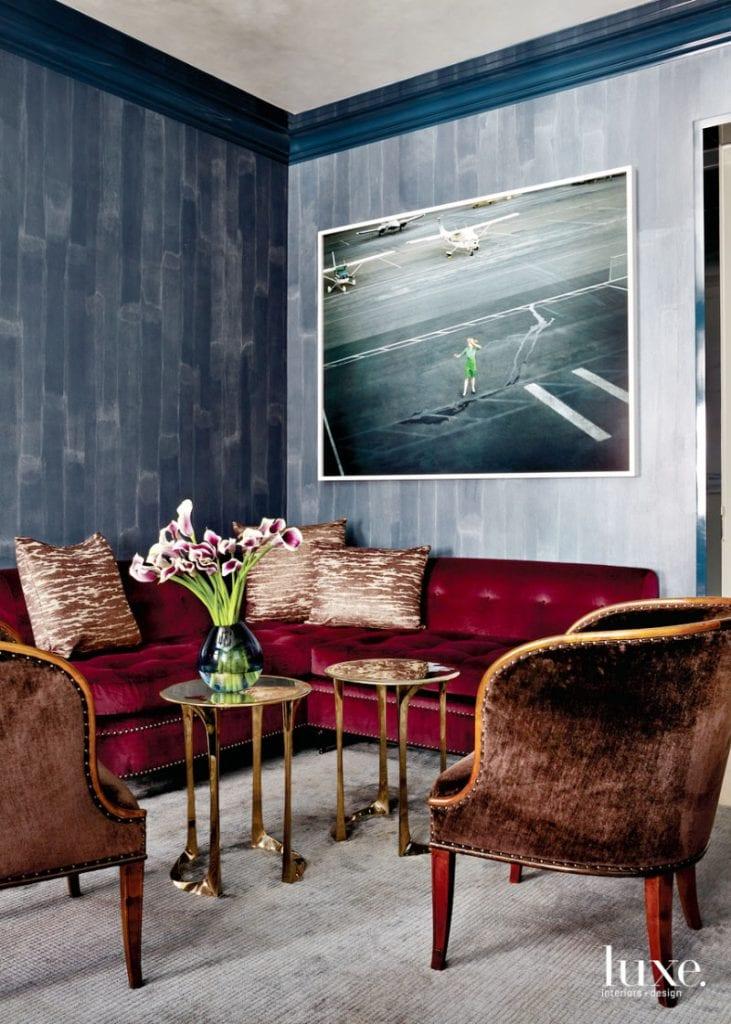 Moody study sitting area with red velvet banquette from Luxe Magazine on Thou Swell @thouswellblog