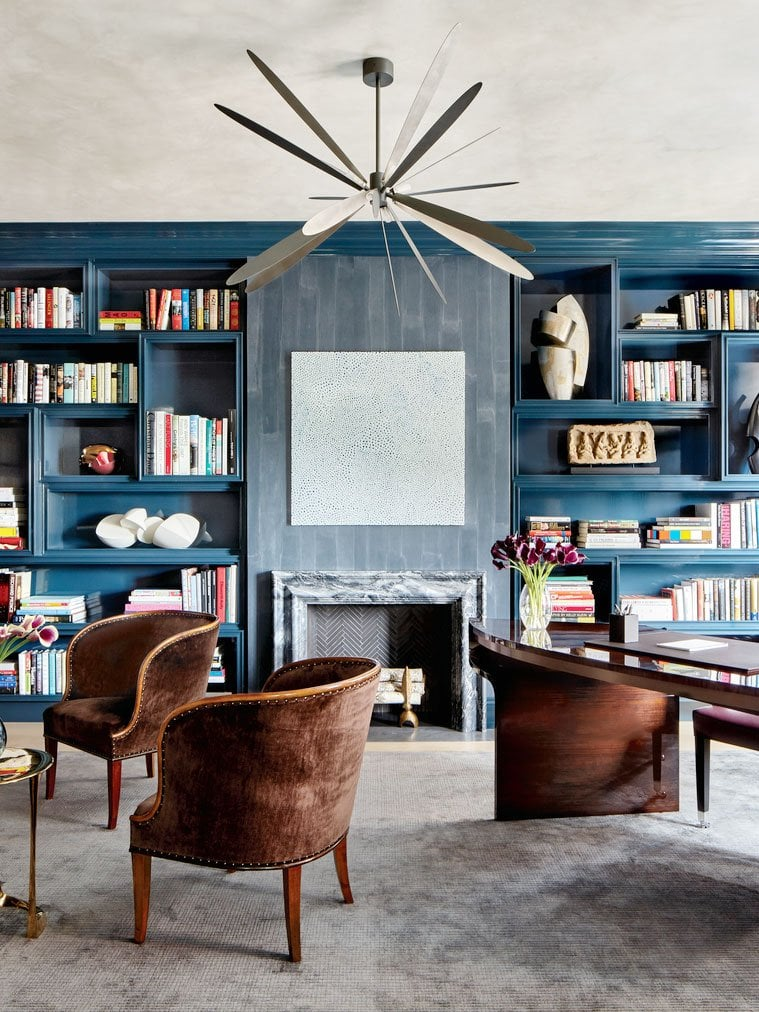Moody study home office with blue lacquer bookshelves and modern chandelier from Luxe Magazine on Thou Swell @thouswellblog
