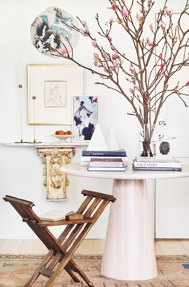 Round entry table with antique floating console table in Atlanta home entryway on Thou Swell @thouswellblog