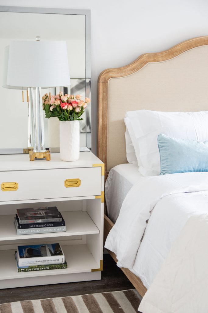 A serene master bedroom design reveal with French-style bed and campaign nightstands with Home Depot on Thou Swell @thouswellblog
