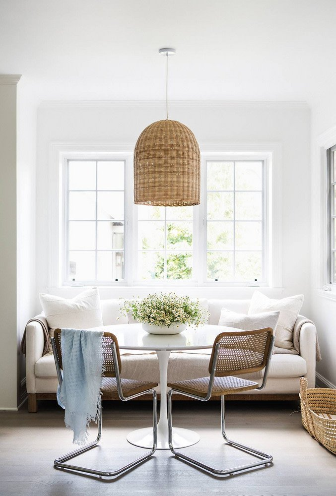 Cane Cesca chairs with wicker pendant in banquette dining nook breakfast table on Thou Swell @thouswellblog