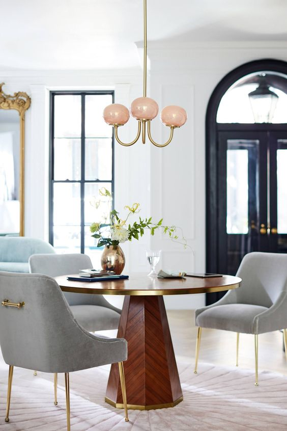Pedestal table and grey velvet dining chairs with pink LED chandelier on Thou Swell @thouswellblog