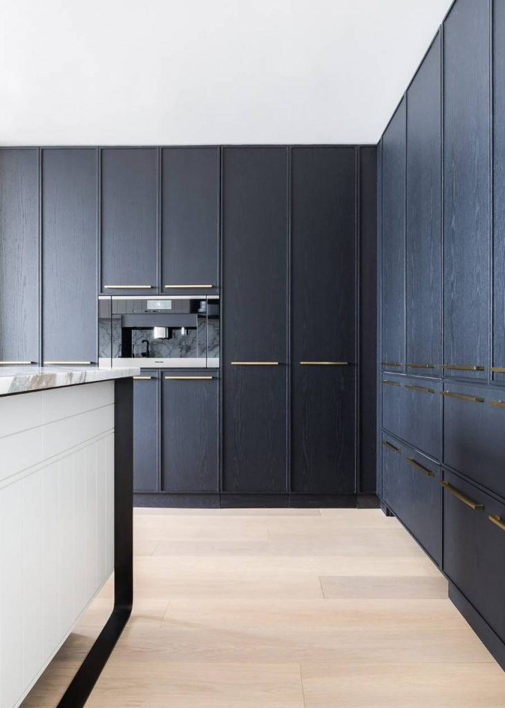Kitchen with black cabinets and hidden storage on Thou Swell @thouswellblog