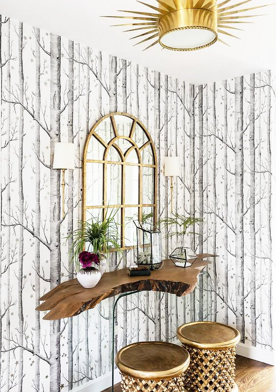 Statement flush mount in gold sun design in entryway with tree wallpaper on Thou Swell #flushmount #statementlighting #entryway