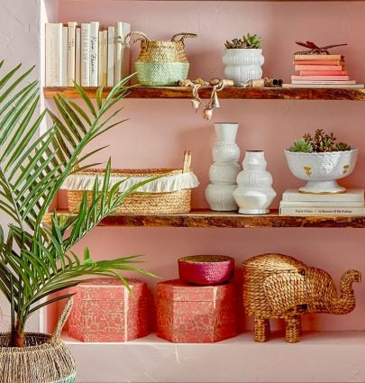 Pink home decor bookshelf styling with bohemian accessories on Thou Swell #homedecor #pinkdecor #bookshelfstyling
