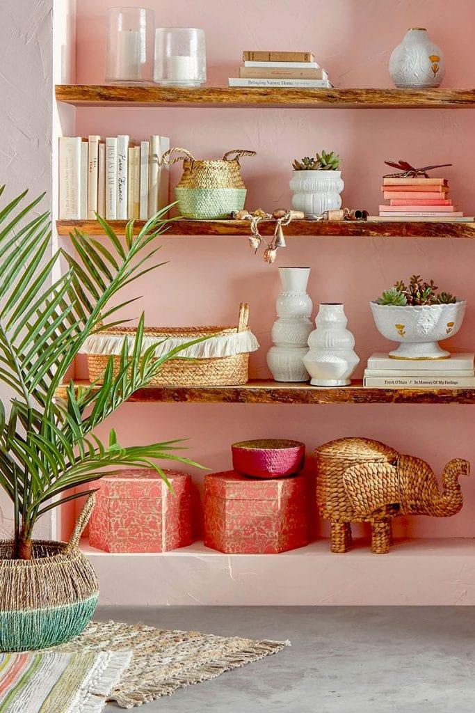 Pink home decor bookshelf styling with bohemian accessories on Thou Swell #homedecor #pinkdecor #bookshelfstyling