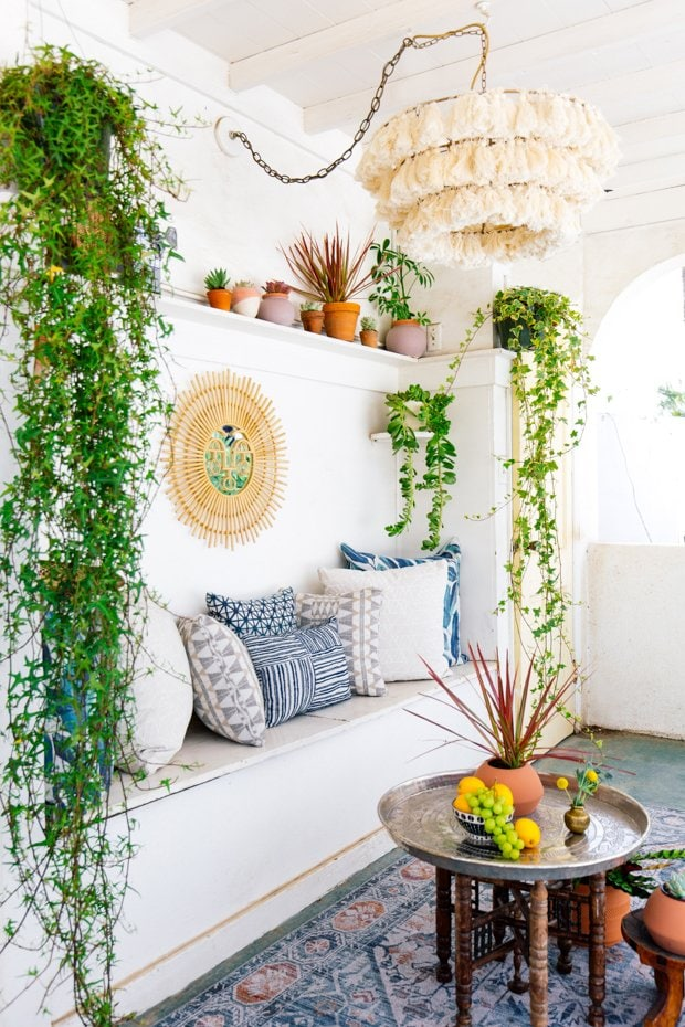 Inside Out performance fabric design by Justina Blakeney, Jungalow sun room with bench pillows and plants on Thou Swell #fabricdesign #outdoorfabric #insideout
