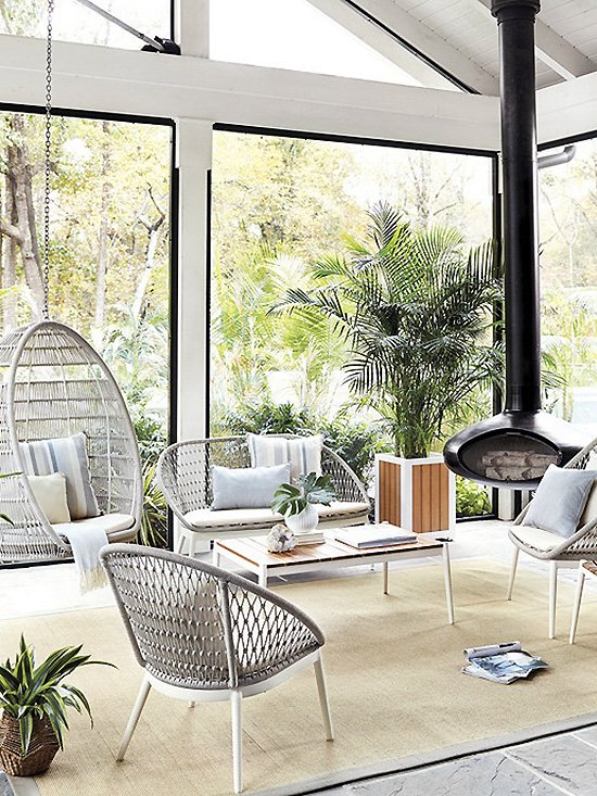 Midcentury modern sunroom with outdoor furniture by Ballard Designs on Thou Swell @thouswellblog #sunroom #homedecor #decor