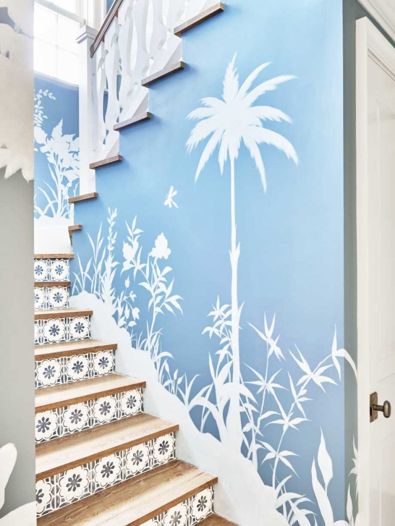 Blue and white staircase with tile risers and palm tree wallpaper in Palm Beach on Thou Swell #hometour #palmbeach #staircase #coastaldecor