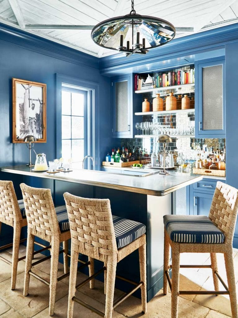 Blue bar with wicker counter stools in Palm Beach house on Thou Swell #hometour #palmbeach #bar #coastaldecor