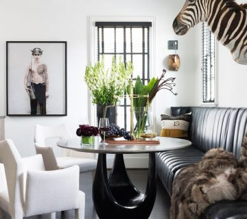 Ryan Hughes home in Midtown Atlanta, dining room with faux zebra head and banquette seating #diningroom #atlantahome #housetour #moderndiningroom