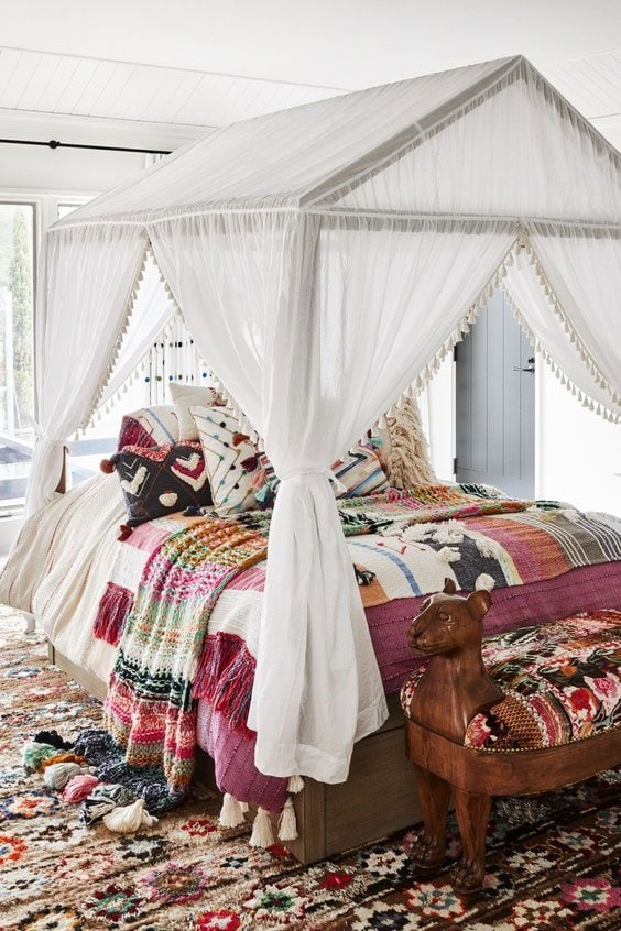 Playful bohemian canopy bed kids bedroom on Thou Swell #livingroom #livingroomdesign #austinhome #hometour