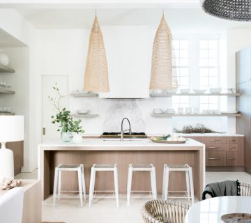 Modern coastal kitchen design with wicker pendants on Thou Swell #coastal #coastaldesign #coastalkitchen #modernkitchen #kitchendesign #kitchen