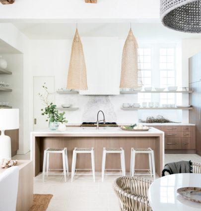Modern coastal kitchen design with wicker pendants on Thou Swell #coastal #coastaldesign #coastalkitchen #modernkitchen #kitchendesign #kitchen
