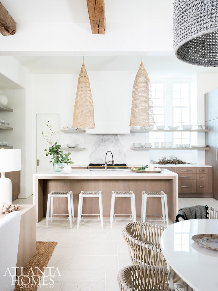 Modern coastal kitchen design in Alys Beach home with wicker pendants on Thou Swell #coastal #coastaldesign #coastalkitchen #modernkitchen #kitchendesign #kitchen