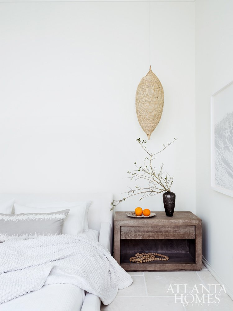 Minimal beach bedroom with wicker pendant light on Thou Swell #coastaldesign #coastal #bedroom #bedroomdesign