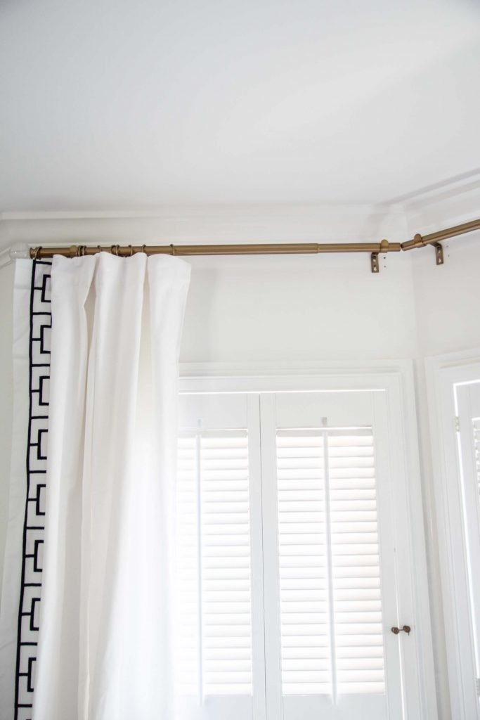 Installing curtains in a bay window with Ballard Designs embroidered curtains on Thou Swell @thouswellblog