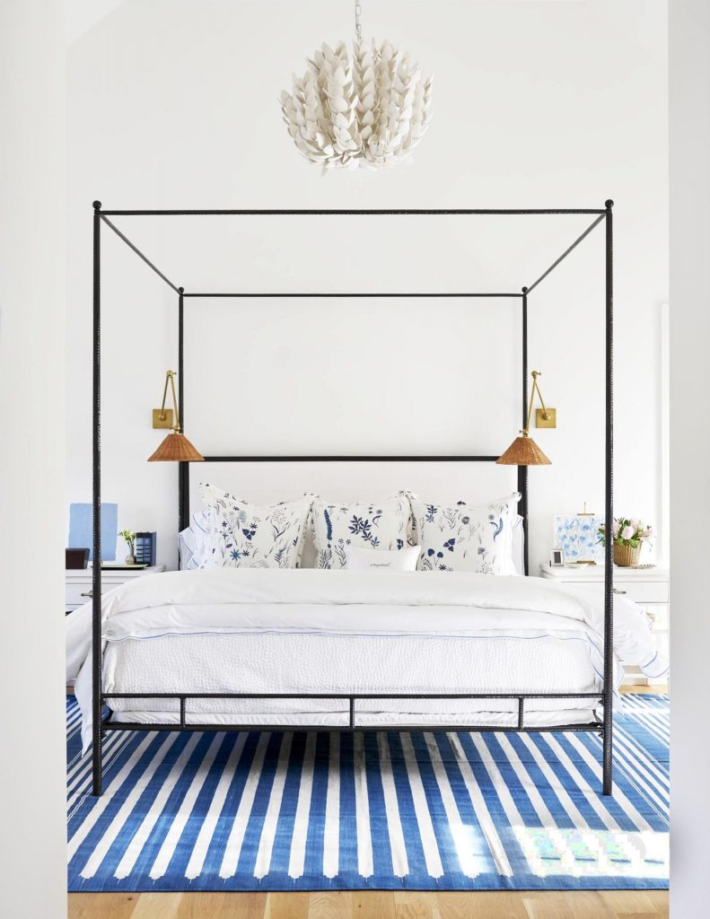 Classic blue and white bedroom with striped rug and canopy bed on Thou Swell #bedroom #bedroomdesign #blueandwhite #bluebedroom #interiordesign