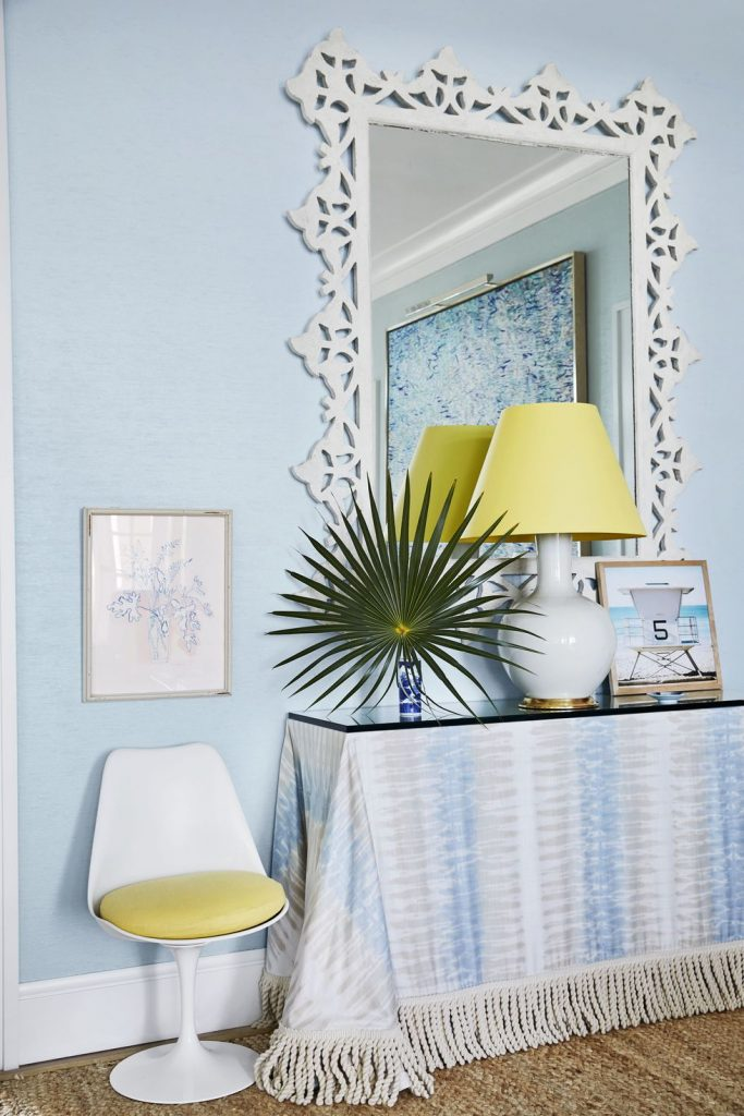 Blue and white vignette with skirted table and yellow accent decor designed by Miles Redd on Thou Swell #skirtedtable #blueandwhite #bluedecor #coastaldecor #coastaldesign #bahamas #beachhouse #milesredd