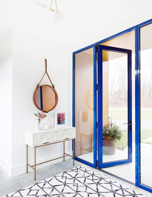 Blue and white entryway with modern doors on Thou Swell #entryway #entry #entrydesign #blue #blueandwhite #modern