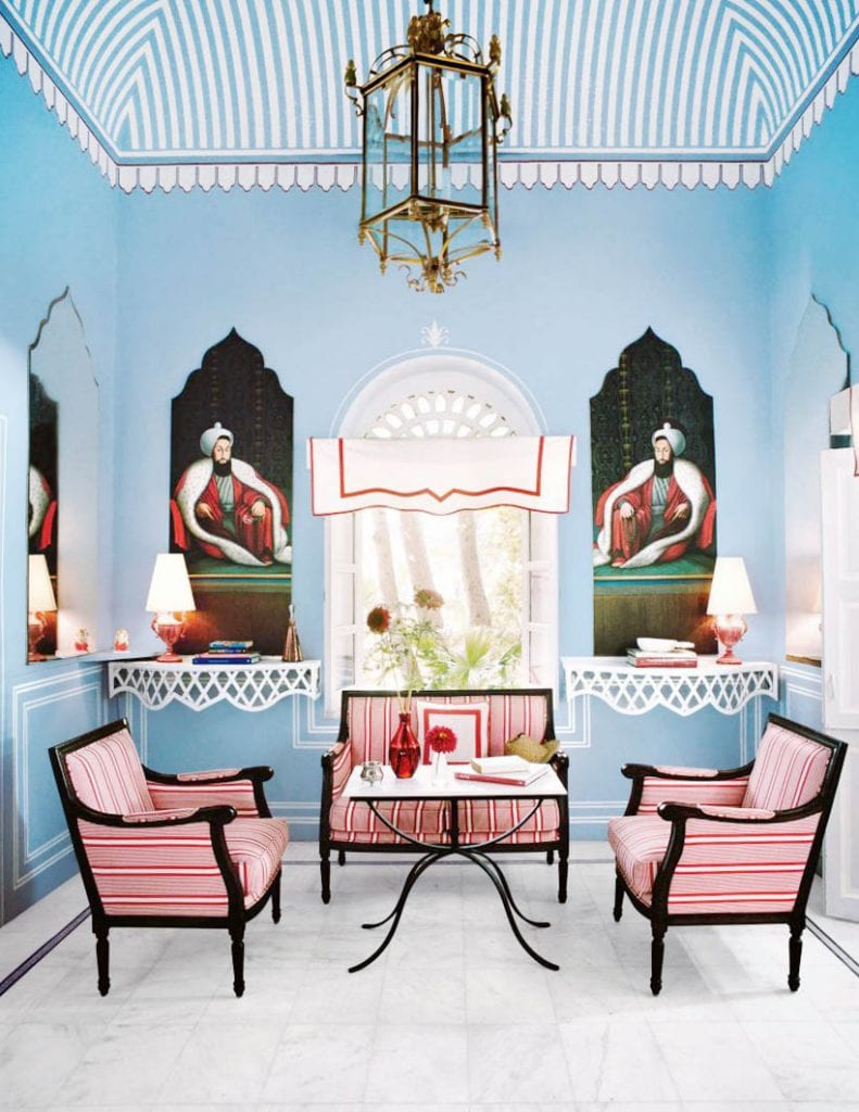 Red white and blue living room in Jaipur, India on Thou Swell #livingroom #redwhiteblue #indianinterior #indiandesign #indianapartment #luxurydesign