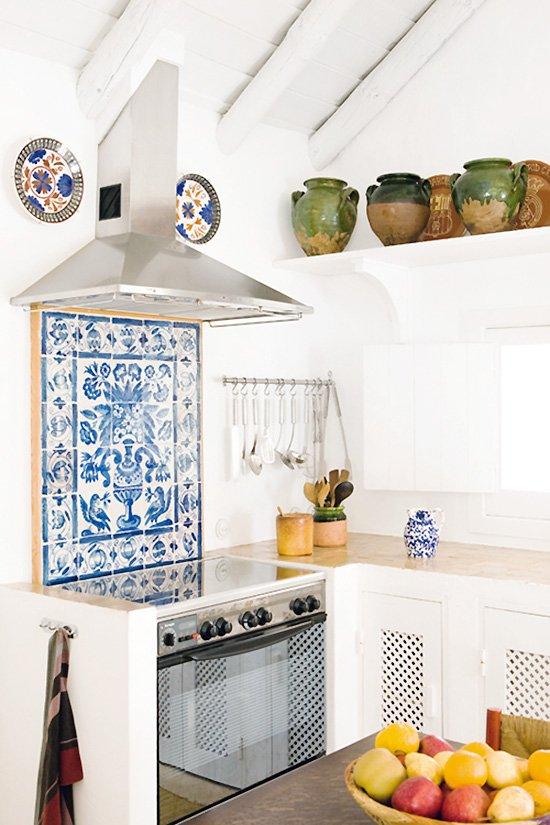 Blue and white tile in a kitchen in Portugal on Thou Swell #portugal #kitchen #kitchendesign #blueandwhite #tile #portuguesetile #coastalkitchen