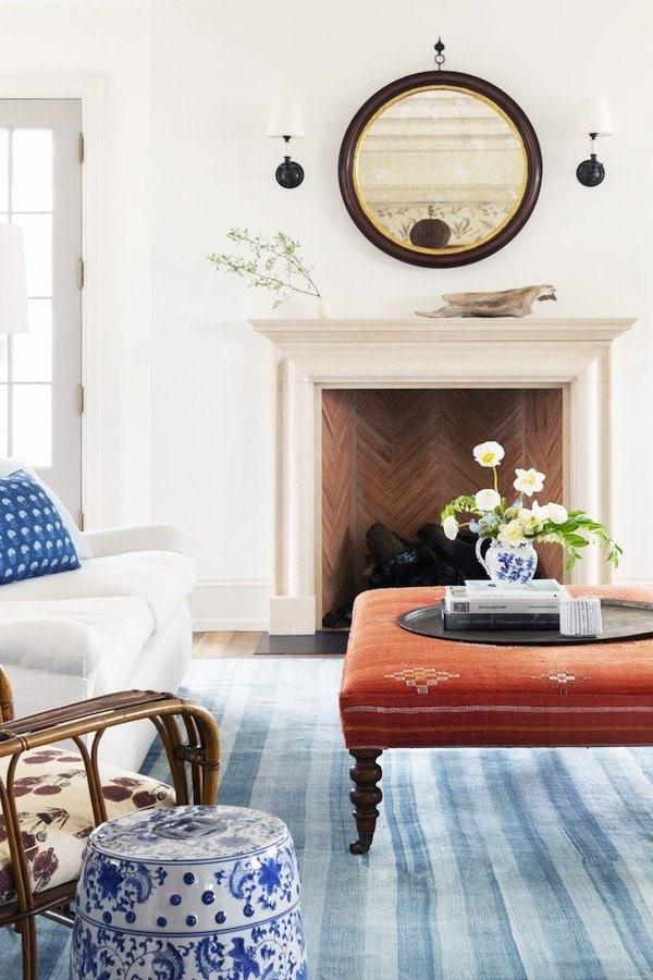 Red white and blue living room with striped rug on Thou Swell #redwhiteblue #blueandwhite #livingroom #livingroomdesign #interiordesign
