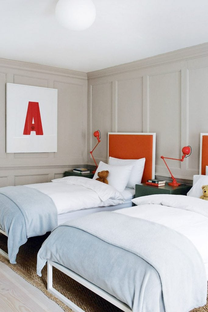 Red headboards in a twin bedroom with blue and white bedding on Thou Swell #twinbeds #twinbedroom #kidsbedroom #bedroomdesign #doublebeds #headboard #redheadboard #interiordesign