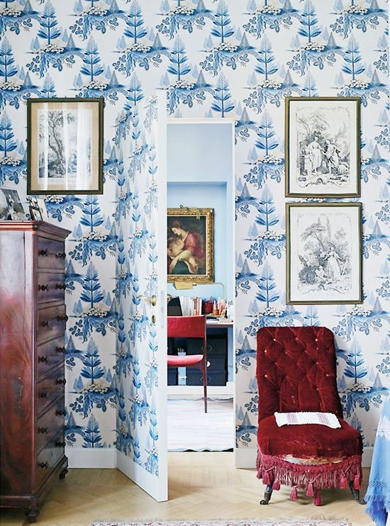 Blue and white wallpaper with jib door in an Italian apartment on Thou Swell #italiandesign #italianapartment #blueandwhite #blueandwhitewallpaper #wallpaper #hiddendoor #jibdoor #interiordesign