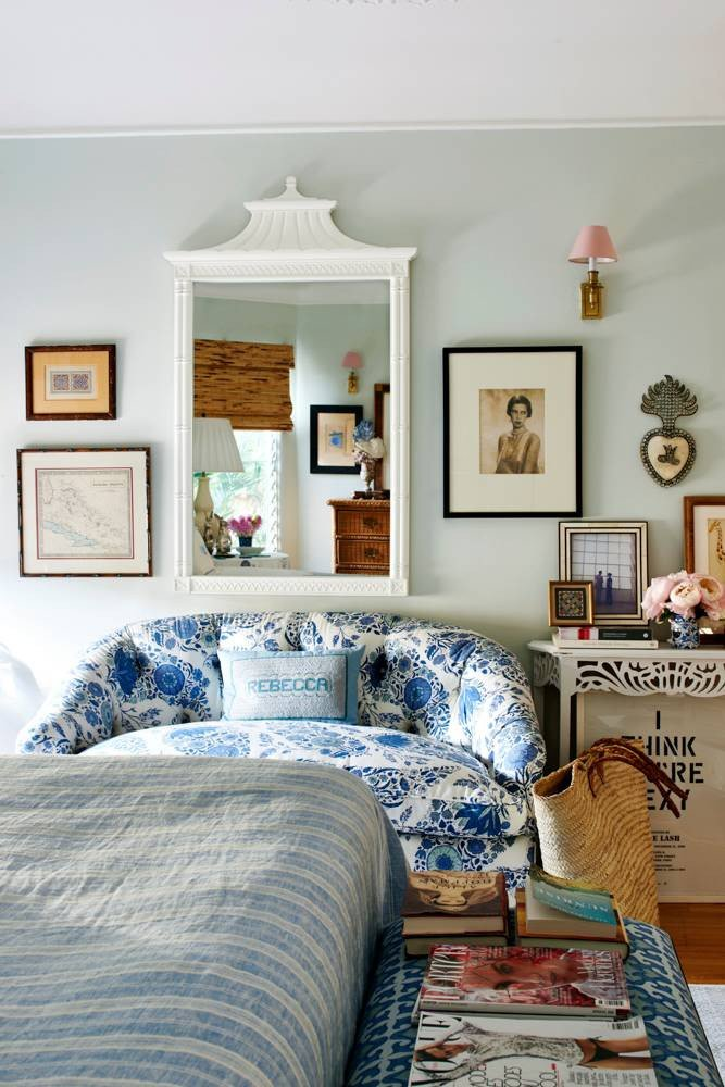 Eclectic blue bedroom with gallery wall and chinoiserie white mirror on Thou Swell #bedroom #bedroomdesign #eclectic #gallerywall #bedroomdesign
