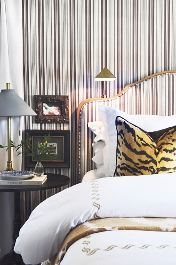 Sophisticated brown striped bedroom with matching headboard on Thou Swell #stripedbedroom #stripedwalls #stripedheadboard #stripes #bedroom #bedroomdesign #interiordesign