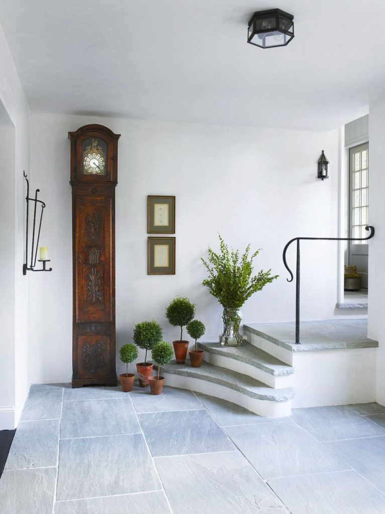 Beautiful back entryway with slate floors and antique clock on Thou Swell in historic Atlanta Tudor house on Thou Swell @thouswellblog #tudor #tudorhouse #renovation #historichouse #historichome #atlantahome #atlantahomes #interiordesign #traditionaldesign #vintagedesign #entry #entryway