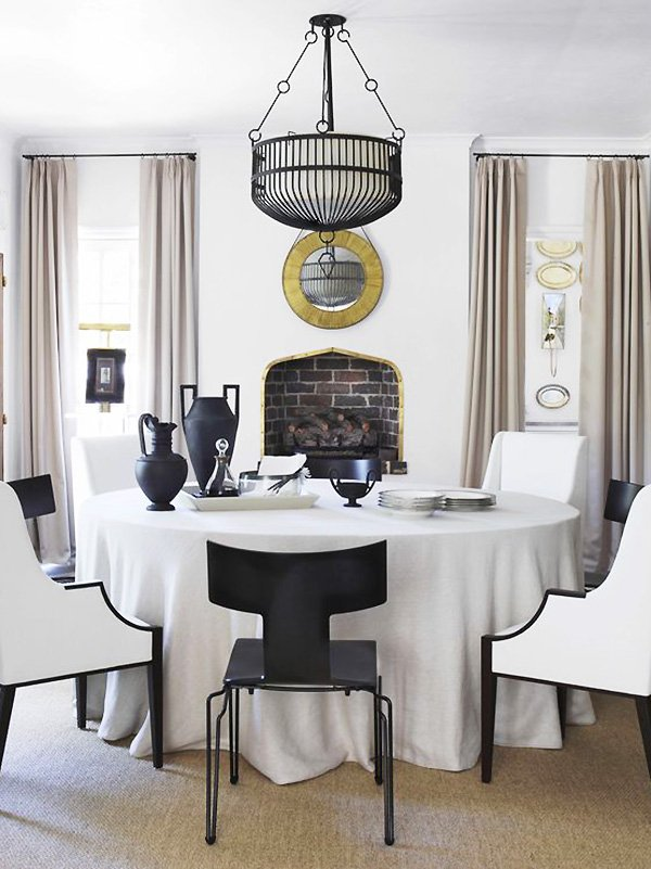 Dining room in historic Tudor house in Atlanta designed by Amy Morris and Stan Dixon with black and white color palette and tan curtains on Thou Swell @thouswellblog #tudor #tudorhouse #renovation #historichouse #historichome #atlantahome #atlantahomes #interiordesign #traditionaldesign #diningroom #diningroomdesign #interiordesign