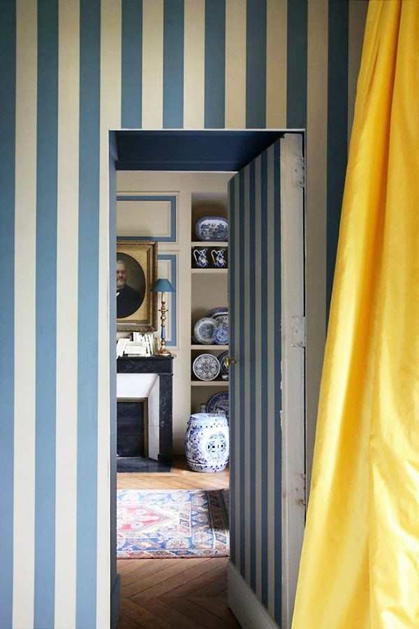 Blue striped walls with yellow curtain and jib door via World of Interiors on Thou Swell #stripes #stripedwall #bluestripes #blueandwhite #worldofinteriors