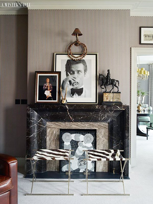 Black marble fireplace with brown pinstripe walls on Thou Swell #stripes #stripedwalls #fireplace #mantel #fireplacemantel #homedecor #interiordesign
