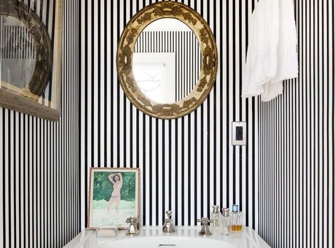 Chic black and white striped bathroom with thin striped and gold antique mirror with pedestal sink on Thou Swell #blackandwhite #striped #stripedroom #stripedwalls #stripedbathroom #bathroom #bathroomdesign #homedesign