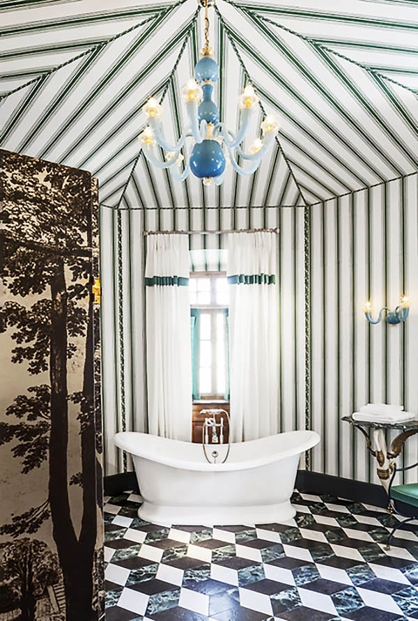 Tented striped bathroom design in a French chateau with green and black marble tile floor on Thou Swell #bathroom #bathroomdesign #stripes #tentedroom #stripedroom #greenstripes #marbletile #tiling #tilefloor #bathroomtile #chateau