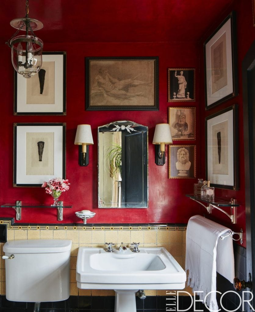 Dramatic red bathroom with gallery wall on Thou Swell #bathroom #bathroomdesign #redroom #redbathroom #gallerywall