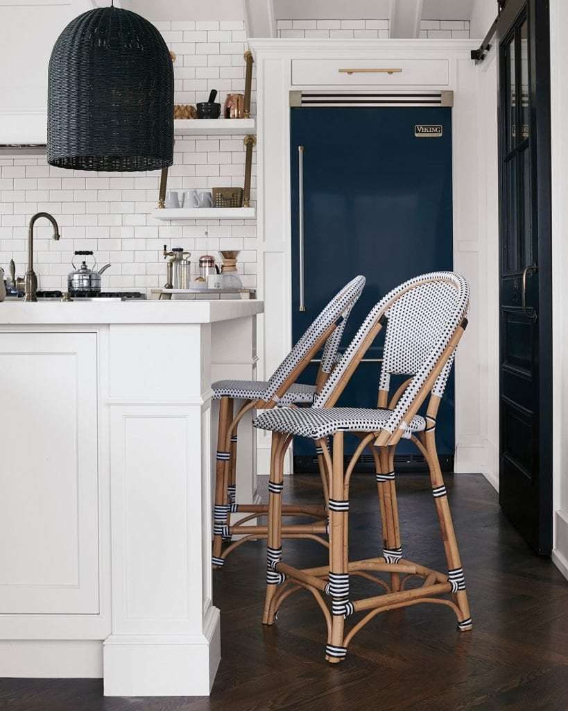 Navy and white kitchen with Riviera woven counter stools on sale now on Thou Swell #kitchen #kitchendesign #bluefridge #blue #blueandwhite #serenaandlily #homedecor #homedecorideas